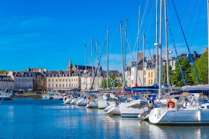 Vannes harbor, in the Morbihan, Brittany, boats in the marina, with typical houses and the cathedral in background